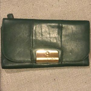 Gently used emerald green Coach wallet